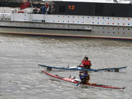 Sarah Outen and Justine Curvengen kayaking on the Thames