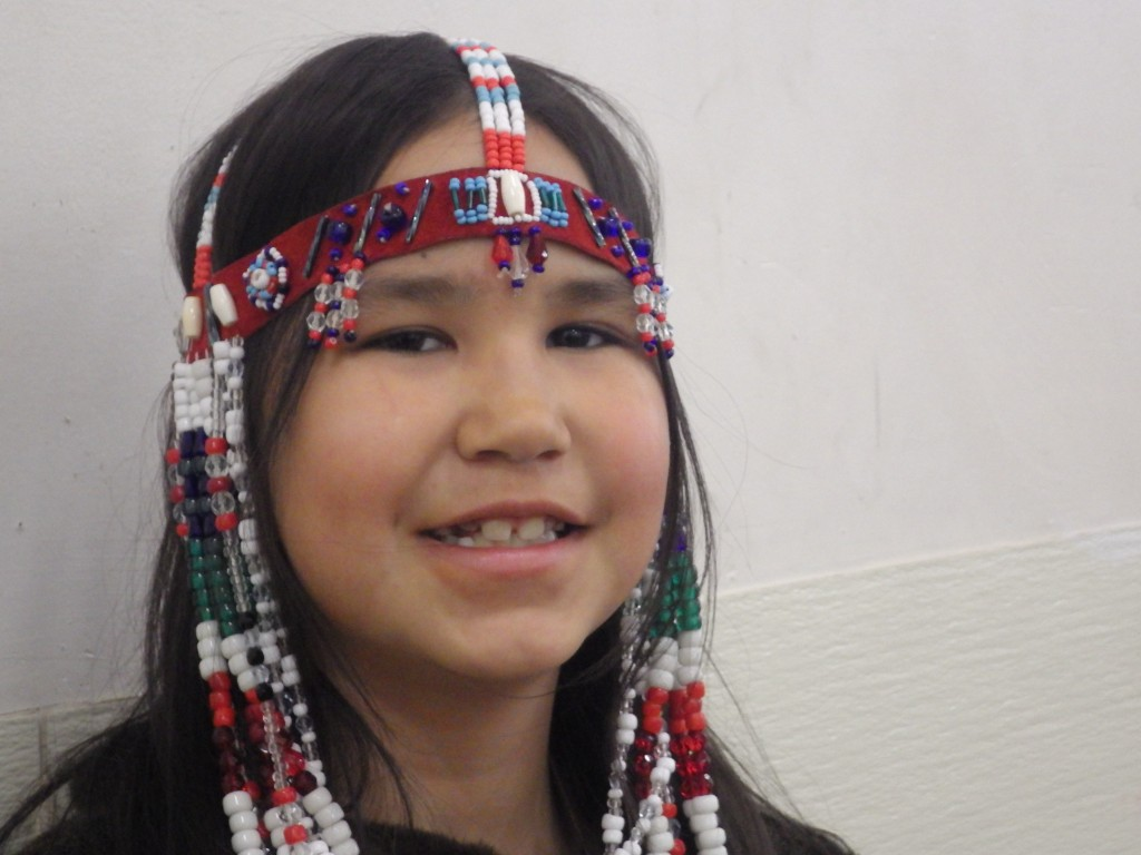 Maria in traditional beaded headdress for the dancing