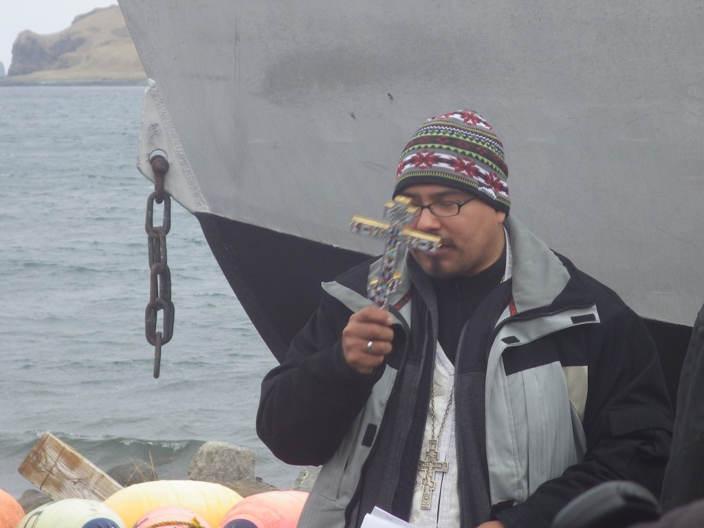 Father Ivan blessing a local fishing boat