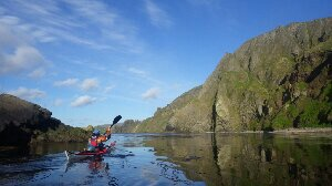 A calm evening 's paddle along Tigalda island