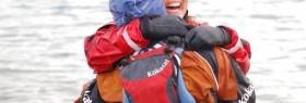 1300 miles went into that hug. Courtesy of Michael Armstrong, Homer (Alaska) News