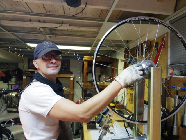Darrell the Bike God works on Herc's back wheel