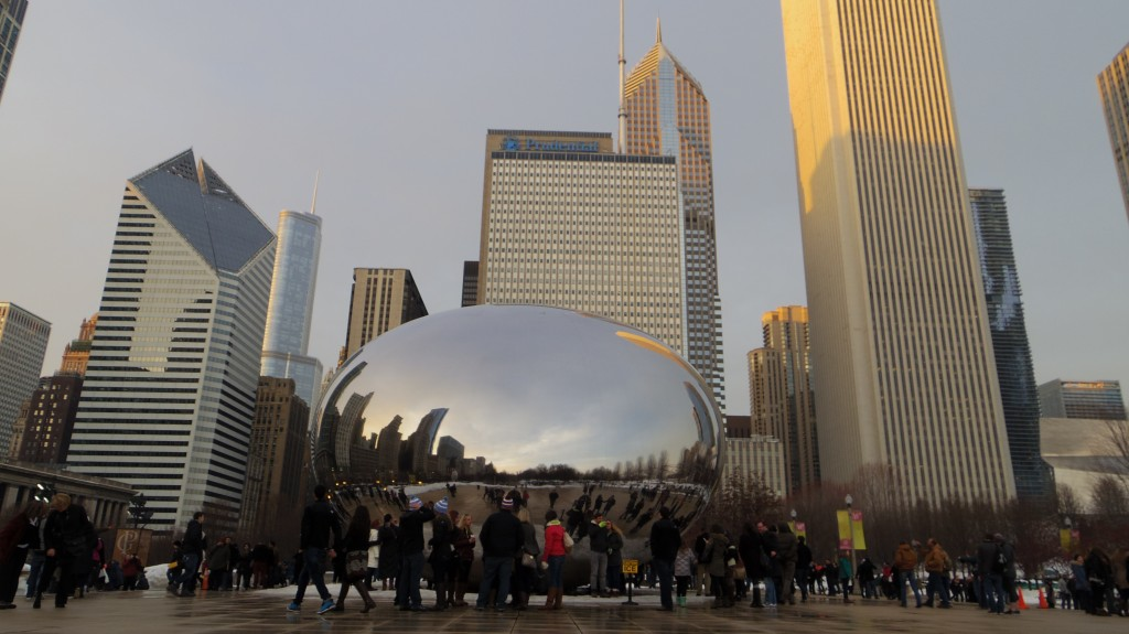 The 'bean' in Chicago's Millennium Park contrasting against the skyscrapersl