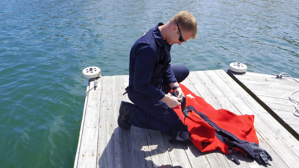 Lt Easley of the US Coast Guard inspects my Survival Suit