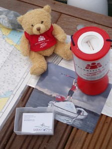Arthur Bear  uses his charm to fill the charity box